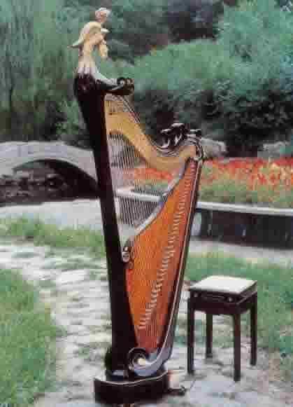 既有外形和西洋乐器竖琴相像的角形箜篌图片