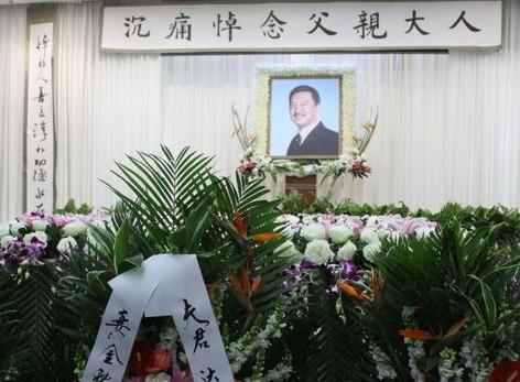 在上海龙华殡仪馆举行了黄达亮的追悼